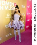 Small photo of New York, NY - December 6, 2018: Ariana Grande wearing dress by Christian Siriano attends Billboard's 13th Annual Women in Music gala at Pier 36