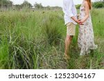 enamored couple walking through ... | Shutterstock . vector #1252304167