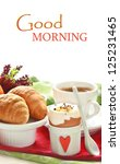 Continental breakfast with croissants, coffee and egg. - stock photo