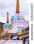 painting on a tibetan stupa in... | Shutterstock . vector #1252418347