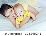 happy mother with baby | Shutterstock . vector #125245241