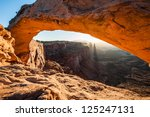 mesa arch glowing at sunrise.... | Shutterstock . vector #125247131