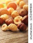 hazelnuts on wooden table | Shutterstock . vector #1252489804