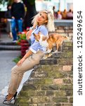 young woman with dog in old... | Shutterstock . vector #125249654