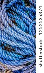 Small photo of Blue used old ropes recurring pattern texture