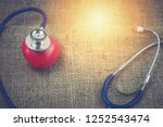 stethoscope and red heart for... | Shutterstock . vector #1252543474