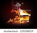 image of glass of burning... | Shutterstock . vector #125258519