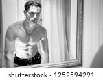 attractive shirtless man with... | Shutterstock . vector #1252594291