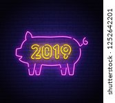 new year pig neon sign  bright... | Shutterstock .eps vector #1252642201