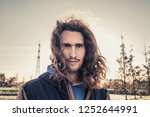 handsome man with long hair | Shutterstock . vector #1252644991
