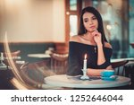 beautiful woman sitting at the... | Shutterstock . vector #1252646044
