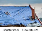 the roofer works on roof when... | Shutterstock . vector #1252683721