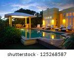 caribbean villa at night  ... | Shutterstock . vector #125268587