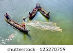 MANDALAY, MYANMAR NOV 20: unidentified  fishermen are fishing on the traditional  way by throwing the net elegant in the water on the Taungthamen Lake on Nov 20, 2011 Mandalay, Myanmar - stock photo