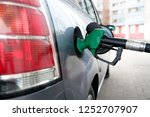 man pumping gasoline into the... | Shutterstock . vector #1252707907