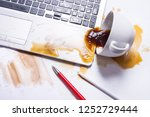 spill coffee on a computer... | Shutterstock . vector #1252729444