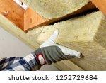 man installing thermal roof... | Shutterstock . vector #1252729684