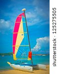 sailboat at the ocean coast ... | Shutterstock . vector #125275505