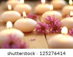 close up of candles and flowers | Shutterstock . vector #125276414
