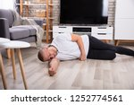 unconscious young man lying on... | Shutterstock . vector #1252774561