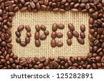coffee beans frame with open text on sacking background - stock photo