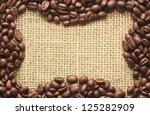coffee beans frame on sacking background - stock photo