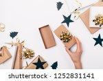 woman's hand opens gift among... | Shutterstock . vector #1252831141