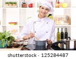young woman chef cooking in... | Shutterstock . vector #125284487