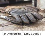 Dirty Old Leather Gloves Of...