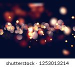 christmas background with bokeh ... | Shutterstock . vector #1253013214