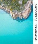 rocky coastline in cool blue... | Shutterstock . vector #1253020297