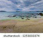tropical beach  stone and beach ... | Shutterstock . vector #1253033374