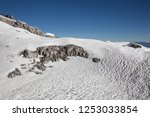 white snow on the rock mountain | Shutterstock . vector #1253033854