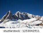 a front of snow rock mountain  | Shutterstock . vector #1253042911
