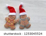 couple gingerbread  in santa... | Shutterstock . vector #1253045524
