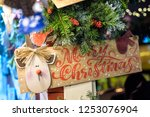 christmas decoration for sale... | Shutterstock . vector #1253076904