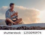happy young handsome man... | Shutterstock . vector #1253090974
