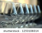 wineglass against blurry... | Shutterstock . vector #1253108314
