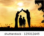 Happy parents making home for kids in beautiful nature - stock photo