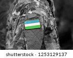 flag of uzbekistan on soldiers... | Shutterstock . vector #1253129137