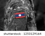flag of laos on soldiers arm.... | Shutterstock . vector #1253129164