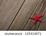 red starfish seashell on old... | Shutterstock . vector #125313071