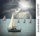 The Sailboats On A Sea Against...