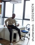 handsome young african man in... | Shutterstock . vector #1253198374