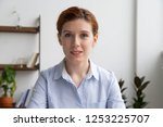 head shot businesswoman sitting ... | Shutterstock . vector #1253225707