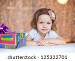 little girl with gift | Shutterstock . vector #125322701