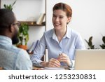 friendly young businesswoman... | Shutterstock . vector #1253230831