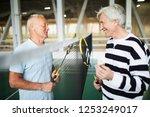 two friendly senior badminton...   Shutterstock . vector #1253249017