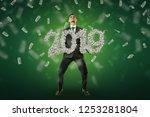 businessman holding a '2019'... | Shutterstock . vector #1253281804