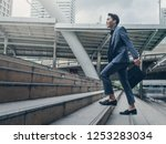 businessman walking at stair in ... | Shutterstock . vector #1253283034